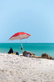 Beach umbrella with a green water sea in Naples, Florida Royalty Free Stock Photography