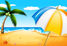 A beach with an umbrella Royalty Free Stock Image