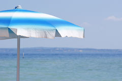 Beach umbrella at the lake Royalty Free Stock Photo