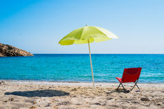 Beach umbrella and lounge chair Royalty Free Stock Photo