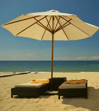 Beach umbrella and lounge chairs Royalty Free Stock Images
