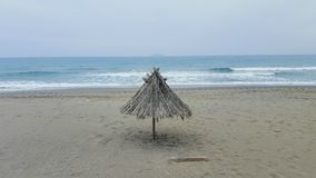 Beach with umbrella. Umbrella at a Beach in low season, Crete Royalty Free Stock Photo