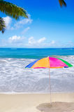Beach umbrella by the ocean Stock Photo