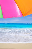 Beach umbrella by the ocean Royalty Free Stock Photos