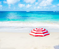 Beach umbrella by the ocean Stock Image