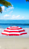 Beach umbrella by the ocean Stock Photos