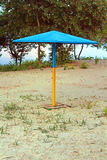 Beach umbrella painted as Ukrainian flag. On a sunny day Stock Images