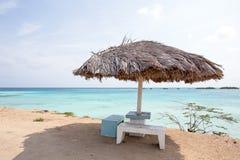 Beach umbrella on Palm Beach in Aruba Stock Image