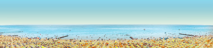 Beach with umbrella and people on blue sky, banner. Panorama Royalty Free Stock Images