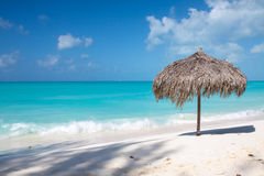 Beach Umbrella on a perfect white beach in front of Sea Royalty Free Stock Images