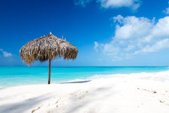 Beach Umbrella on a perfect white beach in front of Sea Stock Image