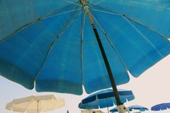 A beach umbrella photographed from below on the background of other beach umbrellas.  stock photo