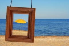 Beach umbrella and photographic frame Stock Photography