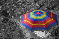 Beach umbrella in rainbow colors Royalty Free Stock Image