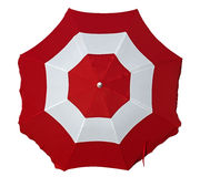Beach umbrella with red and white stripes Royalty Free Stock Photos