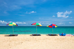 Beach umbrella and ring on beach with blue sky Royalty Free Stock Photo