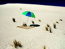 Beach Umbrella on Sandhill Royalty Free Stock Images