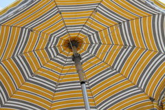 Beach umbrella on sea. A beach umbrella on sea royalty free stock images
