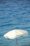 Beach umbrella, sea background Stock Photo