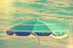 Beach umbrella, sea background, vintage summer. Concept Stock Image