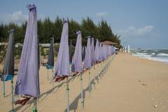Beach umbrella on sea coast. Stock Photos