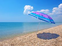 Beach umbrella, sea and sky Royalty Free Stock Image