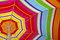 Beach umbrella on a summer day Stock Photos