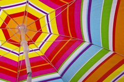 Beach umbrella on a summer day Stock Images