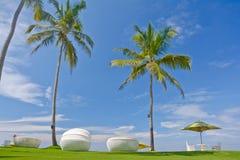 Beach Umbrella And Sunbath Seats Stock Photography
