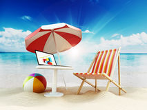 Beach umbrella, sunbed, ball and laptop by the seashore. 3D illustration Stock Photos