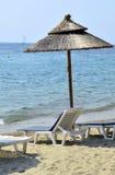 On a beach. Umbrella and sunbeds on a beach stock photos