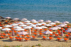 Beach umbrella and sunbeds on the sandy beach Royalty Free Stock Photo