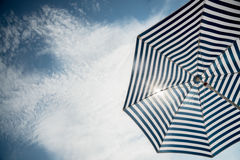 Beach umbrella on sunny day Royalty Free Stock Images