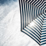 Beach umbrella on sunny day Stock Photography