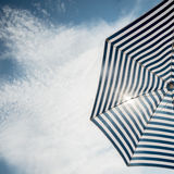 Beach umbrella on sunny day Stock Images