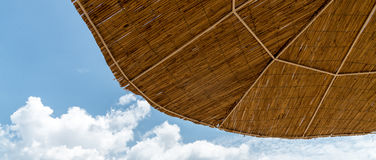 Beach umbrella on sunny day. Beach umbrella on a sunny day with blue sky Royalty Free Stock Photography