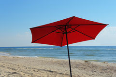Beach umbrella on a sunny day, sea in background Royalty Free Stock Image