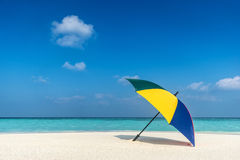 Beach umbrella on a sunny day, sea in background Stock Images