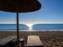 Beach umbrella and sunrise Stock Images