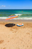 Beach umbrella and toy boat at sea Stock Photo