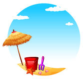 A beach with an umbrella and toys Royalty Free Stock Photos