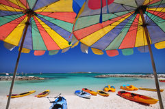 Beach and umbrella. The twin umbrella with beautiful beach and clear sky stock images