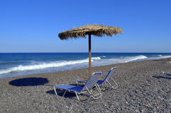 Beach,umbrella and two sunbeds,Santorini,Greece Royalty Free Stock Photos