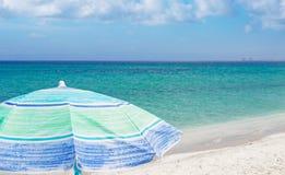 Beach umbrella under a blue sky Royalty Free Stock Photography