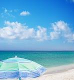 Beach umbrella under a blue sky Royalty Free Stock Photo