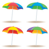 Beach umbrella variety. A group of beach umbrellas in multiple colors isolated on white Stock Image