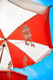 Beach umbrella and the wind bell Royalty Free Stock Photography