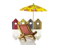 Beach umbrella. Yellow beach umbrella with chair and wooden beach houses Royalty Free Stock Photography