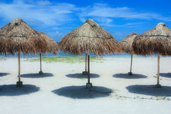 Beach umbrellas. Made of straw and wood on a tropical caribbean island Stock Images
