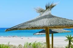 Beach Umbrellas. Blue sky and blue ocean.  Fuerteventura, Spain Stock Photos